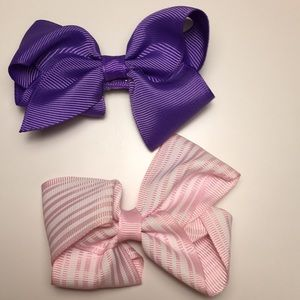 Purple bow and pink white striped hair bow comb.